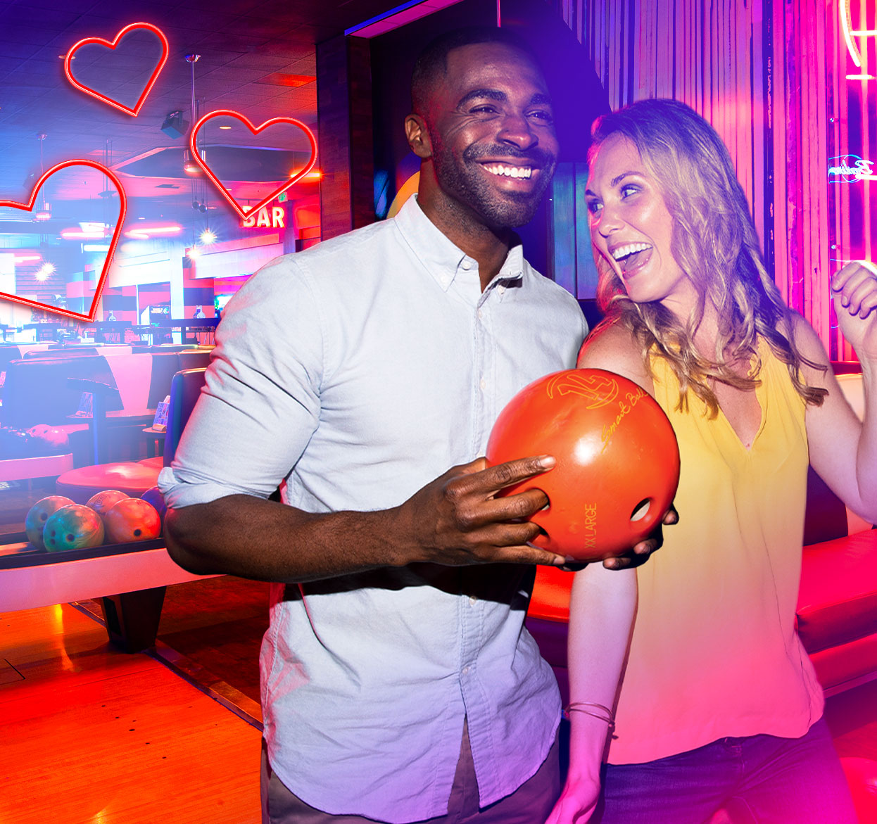 couple holding bowling ball