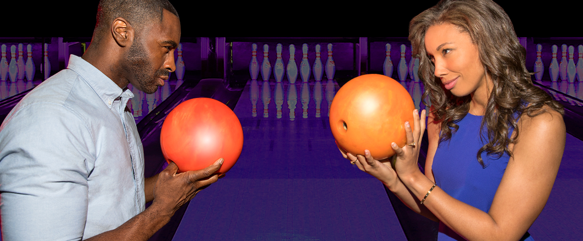 man and woman facing each other with bowling balls