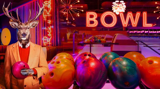 Collage of images of an anthropomorphic illustration of an elk holding a bowling ball wearing a suit, neon signs that say BOWL, and bowling alleys