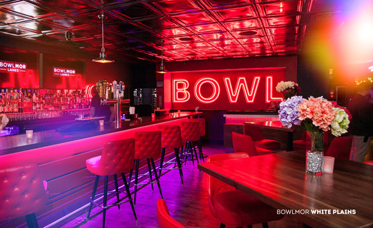 bar area with 'bowl' on the wall in neon lighting