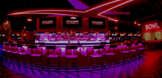 bar area with neon lighting