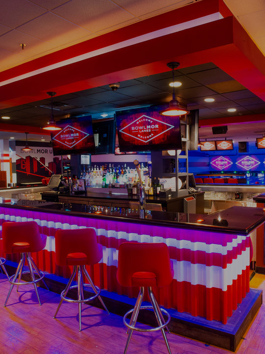 bar area and bar stools with neon lighting