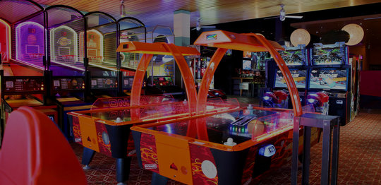Air hockey tables and arcade games