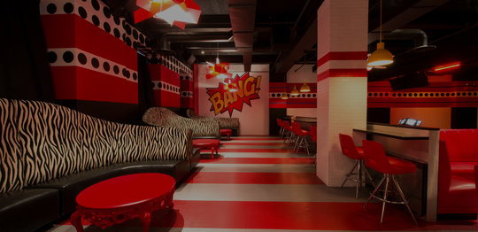 Pop Art lounge and lanes. Zebra print couches and red chairs and walls.