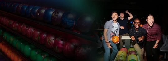 excited people with bowling balls in the background