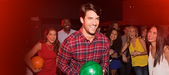 Man holding a green bowling ball