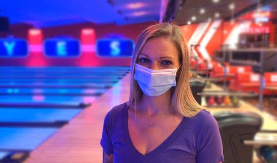 Girl wearing a mask in front of the lanes