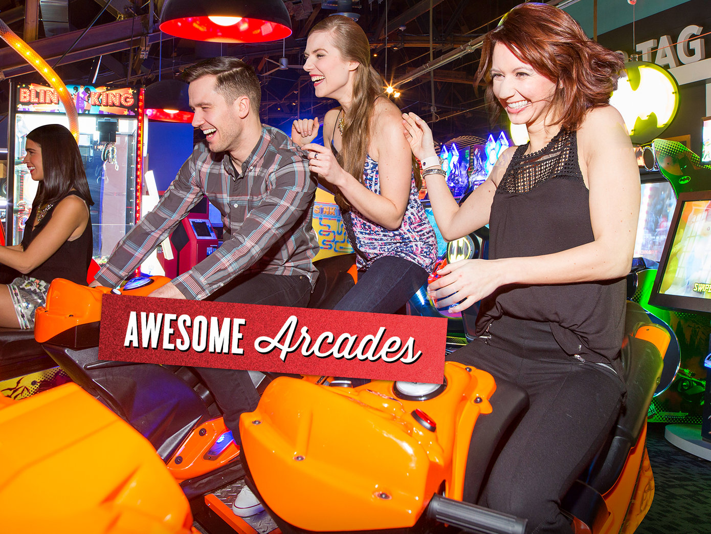 3 young adults playing on an arcade game having fun. It reads 'Awesome arcades' on top in red foil.