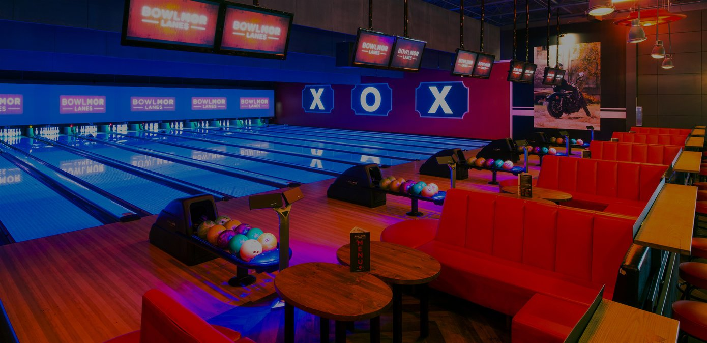 bowling lanes with red plush couches