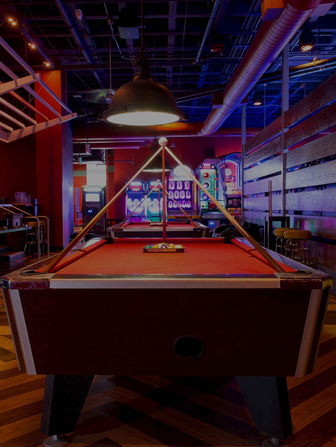 pool table with arcade area in background