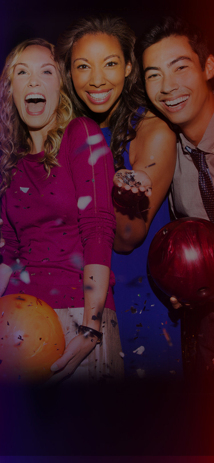 3 friends holding bowling balls and smiling with confetti raining down